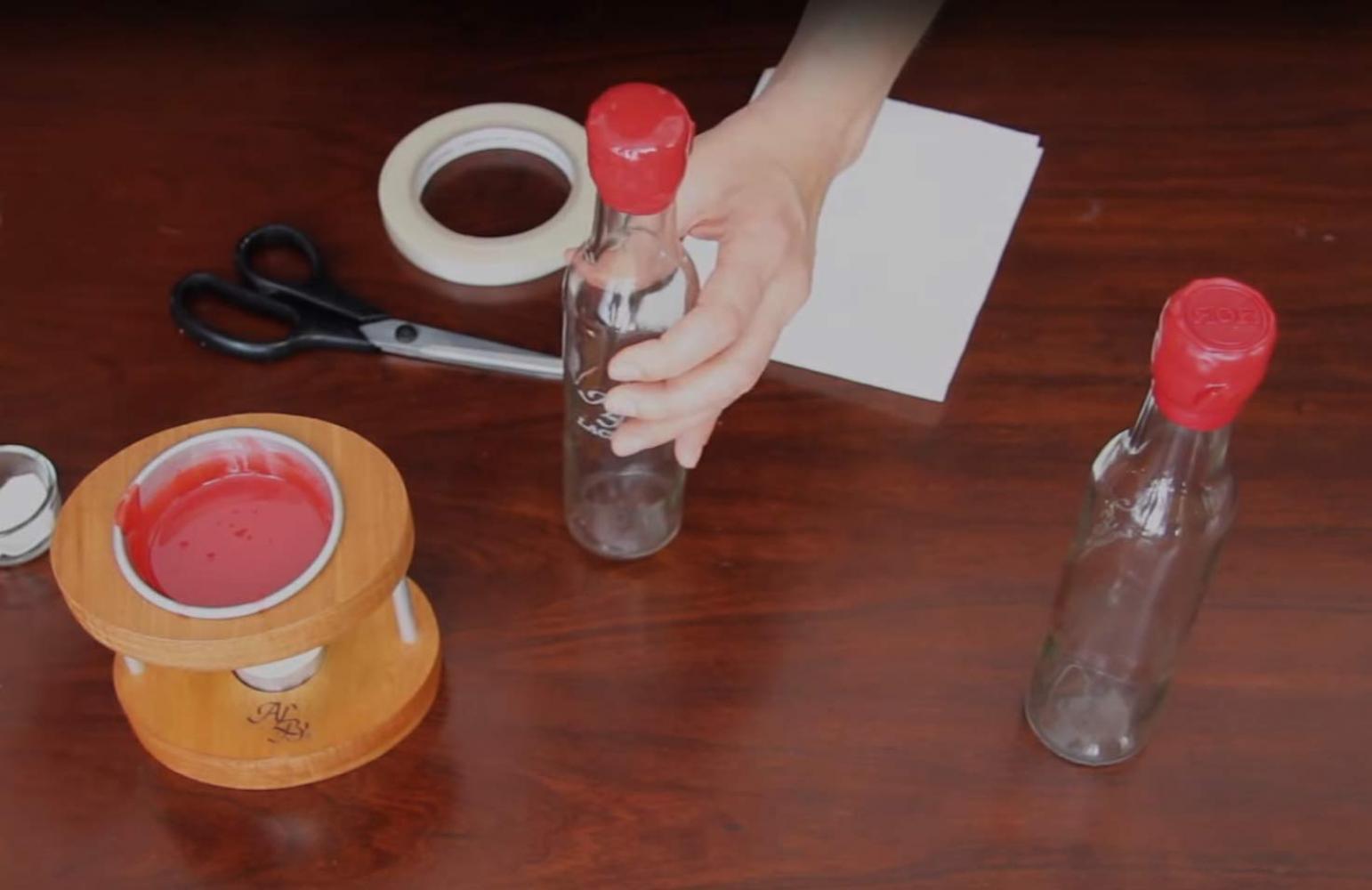 Cómo lacrar botellas con un lacrador personal
