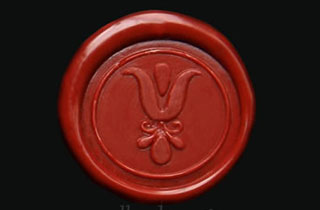 Medallón de lacre barro con sello de flor griega