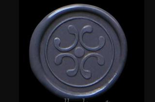 Medallón de lacre color gris estampado con sello de aros